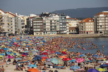SANXENXO, SPAIN - AUGUST 12, 2019: Silgar beach in Sanxenxo full of bathers on a summer day. One of the most important and well-known summer places in Galicia