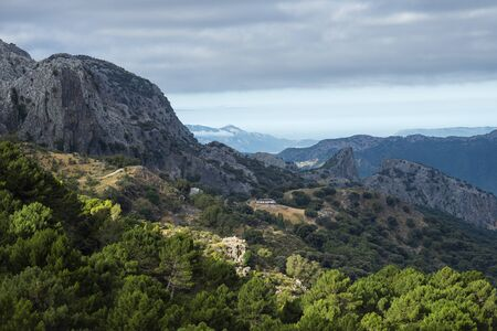Mountainous landscape of the Sierra de Grazalema in Cadiz. View of a farm at the foot of the mountains