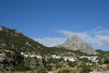 Grazalema, town of the Natural Park of Grazalema, to which it gives its name. View of the white village with the mountains in the background