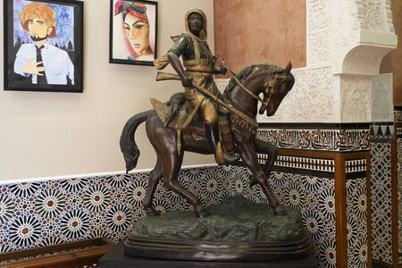 Benalmadena, SPAIN - JUNE 19, 2019: Decorative sculpture of a horse hunter. In the Bil Bil Castle, Benalmadena, Spain Editorial