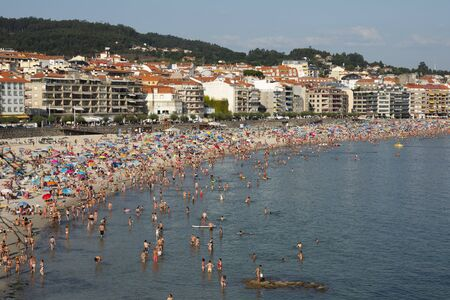 Silgar beach in Sanxenxo full of bathers on a summer day. One of the most important and well-known summer places in Galicia Editöryel