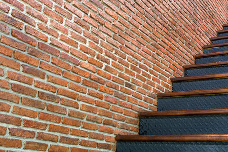 old red brick rough wall with iron stair background Stock Photo