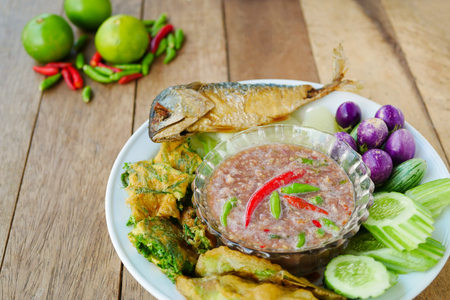 pla: Fried mackerel with shrimp paste sauce and  boiled or deep fried vegetables ,famous Thai spicy food (nam prik kapi pla too) Stock Photo