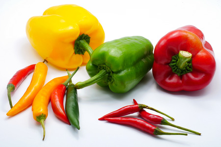 close up food: Multiple color Red green yellow chilli bell and birds eye pepper isolated on white background