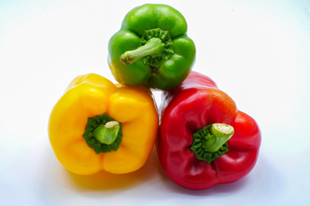 Sweet red green yellow color bell pepper isolated on white background Stock Photo