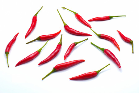 Red bird's eye chilli pepper isolated on white background , close up Imagens