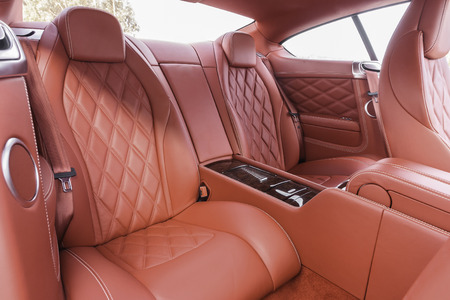 suede belt: Red back passenger seats in modern luxury comfortable car