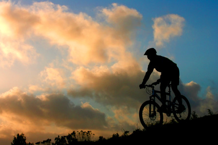 mountain biker: Mountain biker with sunset clouds Stock Photo