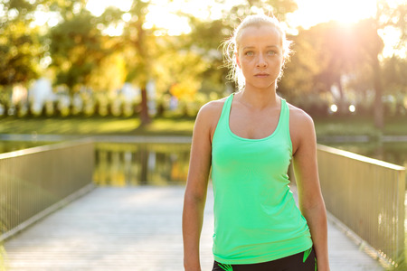 intentional: Active Woman portrait in urban park (intentional sun glare)
