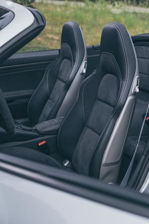 legroom: Leather driver seats in luxury sportscar