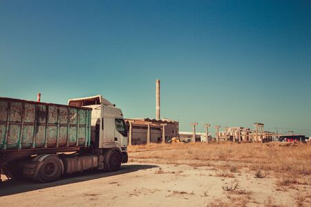 A truck stopped near old factories, Portugal Foto de archivo