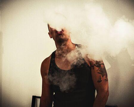 A man smoking an electronic cigarette, vape