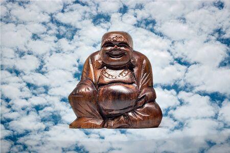 statue de bouddha heureux, charme de prospérité