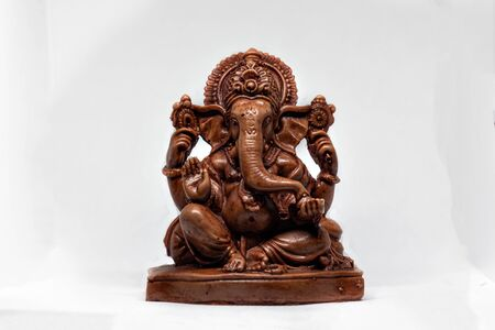 wooden statue of Hindu god Ganesha with a white background, Hindu religion