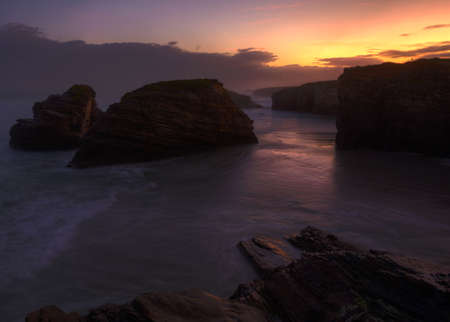 Lonely sunrise on the beach of As Catedrais, in ribadeo, galicia