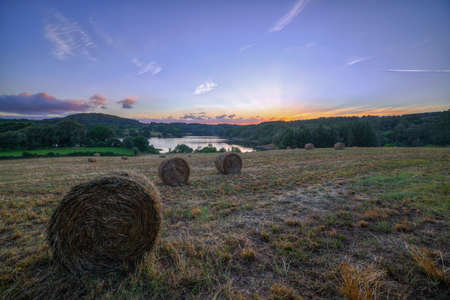Bales of straw in a field at sunset, O Páramo, Lugo, Galicia