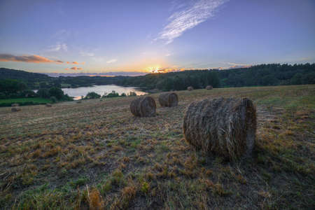 Sunset in a field with bales of straw in O Páramo, Lugo, Galicia