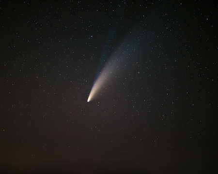 Comet C2020F3 Neowise displaying its blue ionic tail and a larger yellowish white ice dust tail Reklamní fotografie