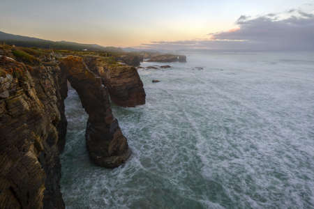 High tide at sunrise on the beach of As Catedrais, in Ribadeo, Galicia Foto de archivo