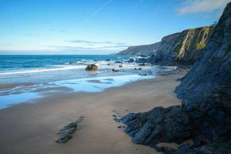 Deserted beach under the black slate cliffs in Loiba Espasante Galicia Banco de Imagens