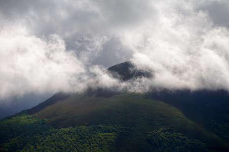 Play of light and shadow between clouds and glades in the mountains in Ancares Cervantes Galicia Banco de Imagens