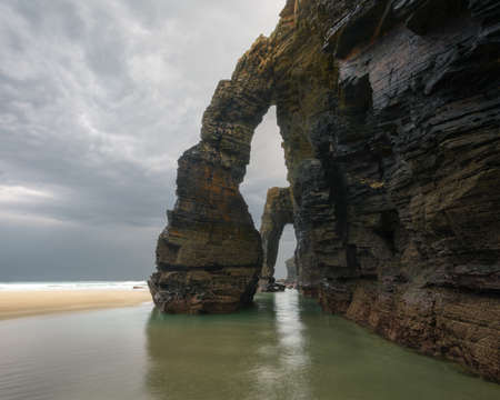 The famous stone arches of As catedrais beach on a cloudy day in ribadeo Galicia