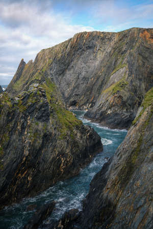 Wild cliffs faded by the Cantabrian Sea in Loiba Espasante Galicia