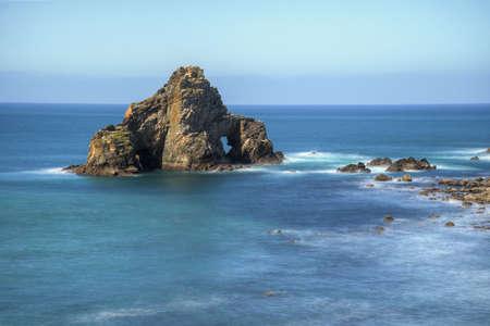 Marine rocky cliff with two arches in Penafurada Espasante Galicia Banco de Imagens