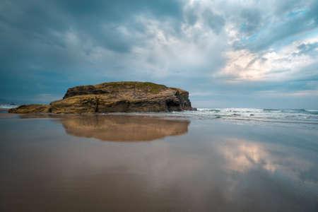 Cloudy sky and low tide at As Catedrais beach in Ribadeo Lugo Galicia Banco de Imagens