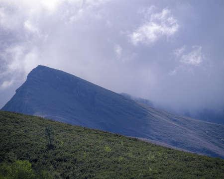 A dark storm cloud hides the mountains of Seoane do Courel Galicia Banco de Imagens