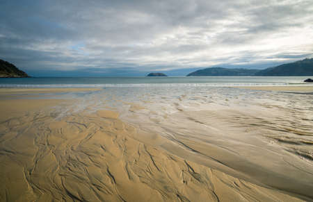 Patterns and reflections created by the ebb tide on a beach in Estaca de Bares in Galicia Banco de Imagens
