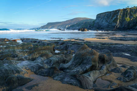 Interesting geological formations on a beach located in the Ortigueira Geopark in Galicia