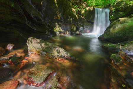 Waterfall and pond in the course of a river in the Courel mountains geopark in Galicia