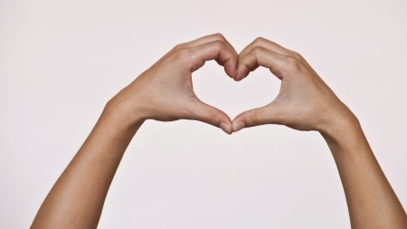 shaping: Female hands shaping a heart