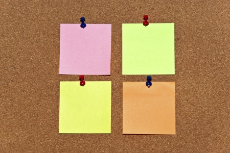 Post it notes on wooden background photo