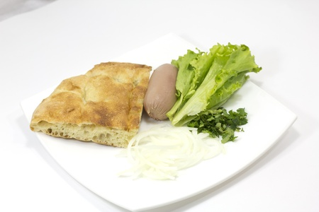 verdure: hot dog, verdure, onion and bread on white background
