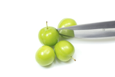 offshoot: plum cut by knife on white background Stock Photo