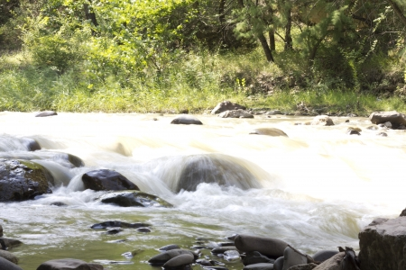 spume: quick mountain river on long endurance Stock Photo