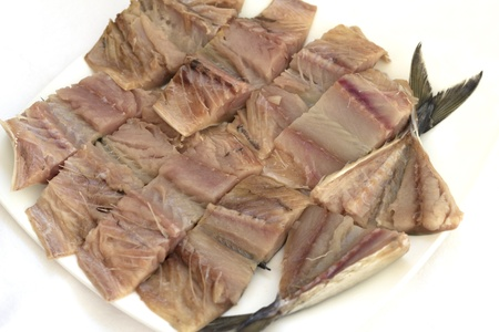 frozen meat: sliced pieces of mackerel on a white plate Stock Photo
