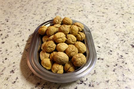 Platter with nuts, nuts or fruit, common-Walnut Fruit (Juglans regia L).