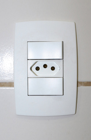 volts: Electric switch with electrical outlet 110220 volts. Stock Photo