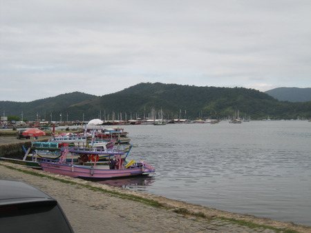 tour boats: Tour boats in the port of Paraty - Serra do Mar in the background, Paraty, Rio de Janeiro, Brazil , in 2015. Editorial