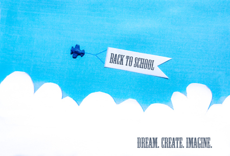 Blue plane pulling a white banner on blue sky. White clouds. Concept.