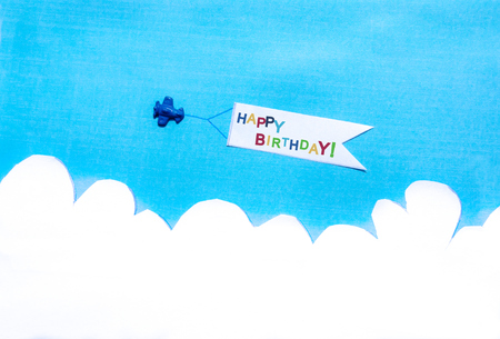 background  paper: Blue plane pulling a white banner on blue sky. White clouds. Concept.