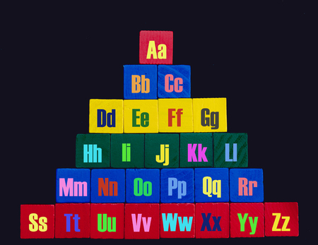 Colorful Alphabet as a pyramid made of wood blocks Banque d'images