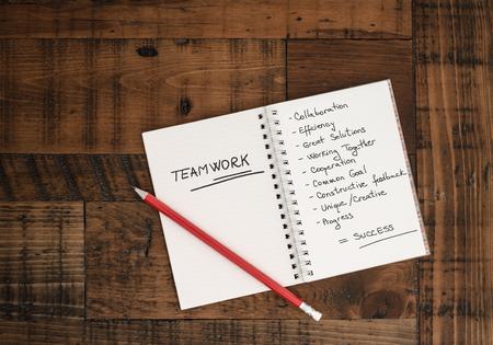 handwritten: Teamwork - concept - hand-written in notebook Stock Photo