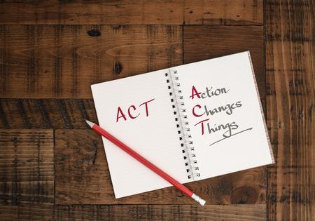 ACT  concept hand-written in notebook Reklamní fotografie