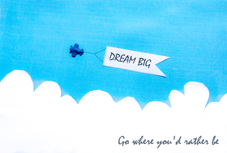Plane pulling banner on blue sky with clouds Concept image