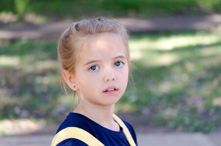 Portrait of a young blonde, blue-eyed girl outdoor Banque d'images