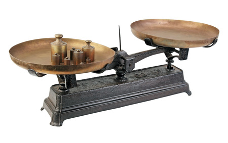 weigh machine: Isolated old weight against a white background.